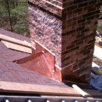 "Copper chimney/roof ""cricket""."
