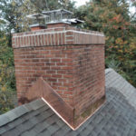 copper flashing around the chimney roofline