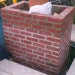 preparing to set the chimney crown