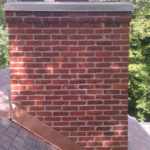 chimney cap installed with copper flashing