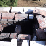 re-setting the bricks for a chimney